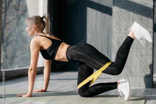 Fitness woman uses elastic band for sport Fototapeta