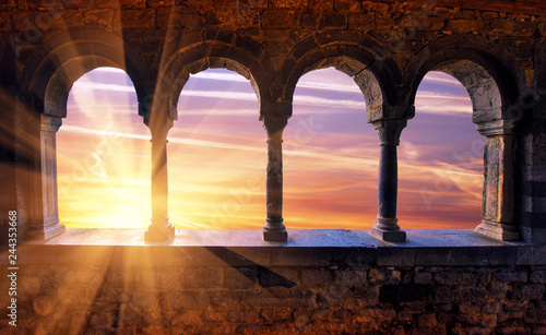 Foto auf AluDibond Braun Abstract scenic scenic landscape with sunset with sunlight through medieval arches. Porto Venere, Italy. Charming places.