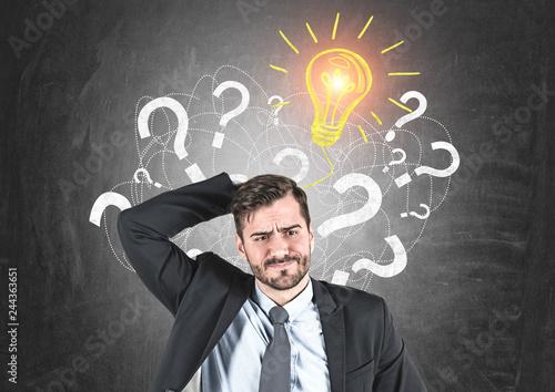 Fotografia Confused businessman, question marks and idea