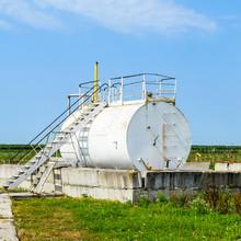 Reservoir For Sludge Of Oil Emulsion. Equipment At The Oil Field