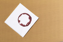 White Napkin With Wine Trace On Textured Background.