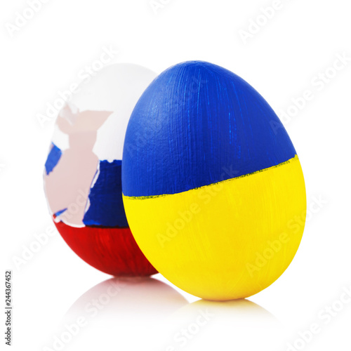 Fotografía  Blow to Orthodoxy: two Easter eggs painted in color of the flags of Russia and U