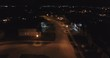 Flying Over Neighborhood Houses On Street At Night Aerial Drone