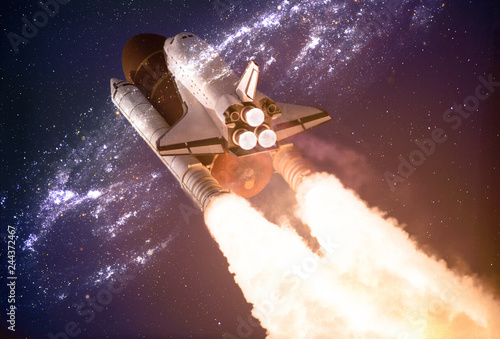 Keuken foto achterwand Nasa Spaceship taking off on a mission throw the warmhole portal in outer space. Elements of this image are furnished by NASA.