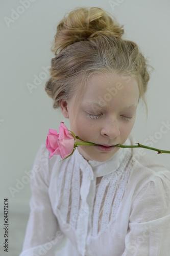 Fotografie, Obraz  albino girl with pink rose posing in Studio on white background