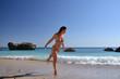 girl in a bathing suit on the beach, Portugal, Atlantic Ocean
