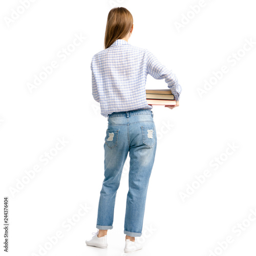 Woman in blue jeans and shirt with books in hands goes on white background isolation, back view