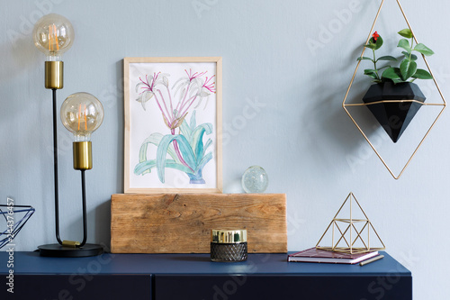 a305155eb ... wooden frame, table lamp, gold pyramid, accessories and hanging plants  in geometric pot on the grey wall background. Minimal concept of navy blue  shelf.