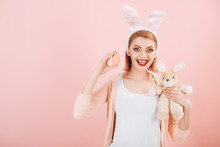 Happy Woman In Bunny Ears With Toy. Spring Holiday. Girl With Hare Toy. Happy Easter. Egg Hunt. Easter Eggs As Traditional Food. Woman In Rabbit Bunny Ears. Copy Space. Easter Is Her Favorite Holiday