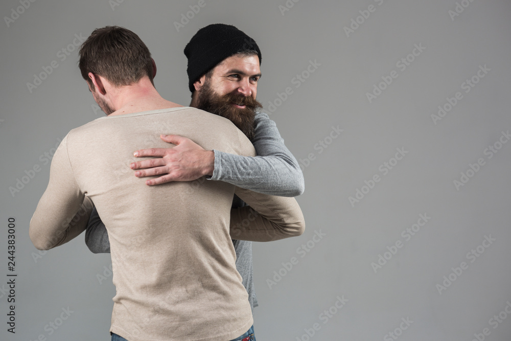 Fototapety, obrazy: True friendship. Happy men in friendly relations. Best friends greeting each other. Bearded man shaking hands and hugging male friend. Bonds of friendship. Meeting of old friends