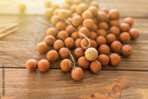 Carp baits on a wooden background.