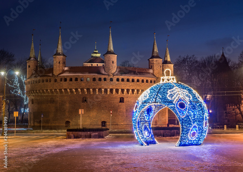Fototapeta Krakow, Poland, Christmas decoration and barbican in the night obraz