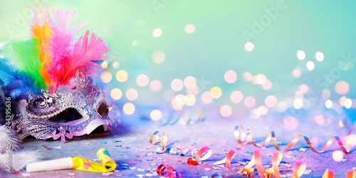 Tuinposter Carnaval Carnival Mask With Blurred Streamer, Party Confetti And Bokeh