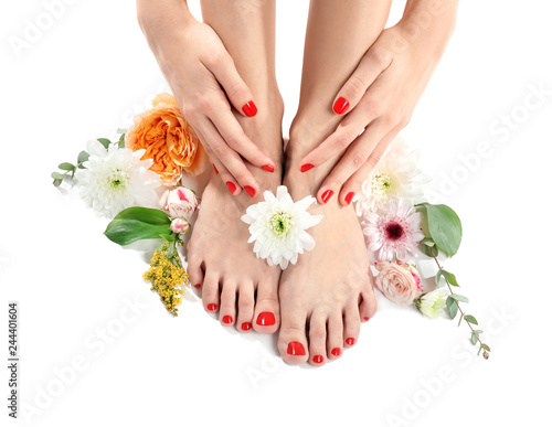 Foto op Canvas Pedicure Young woman with beautiful pedicure and flowers on white background
