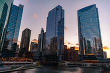 Buildings Along The Chicago River During Sunset