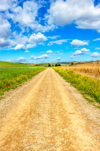 Unpaved Country Road On The Way Of St. James, Camino De Santiago Between Azofra And Ciruena In La Rioja, Spain Under A Beautiful May Sky