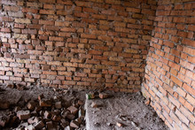 .Brick Corner Of An Old Abandoned Unfinished Building