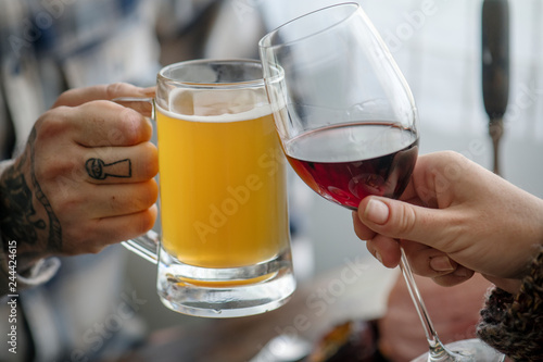 Friends cheering with wine and beer