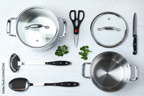 Flat lay composition with clean cookware on white wooden background