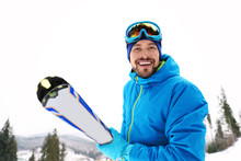 Male Skier On Slope At Resort....