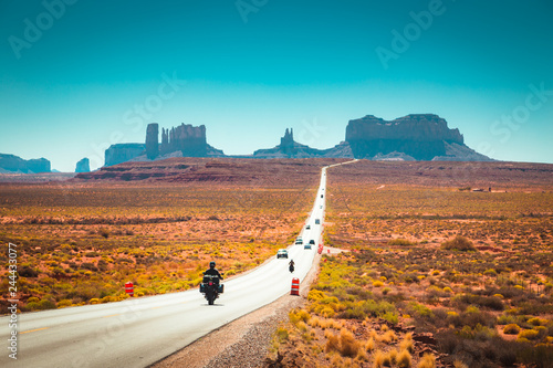 Keuken foto achterwand Route 66 Biker on Monument Valley road at sunset, USA