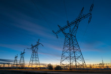 High-voltage Power Lines And High Voltage Electric Transmission Tower In A Twilight