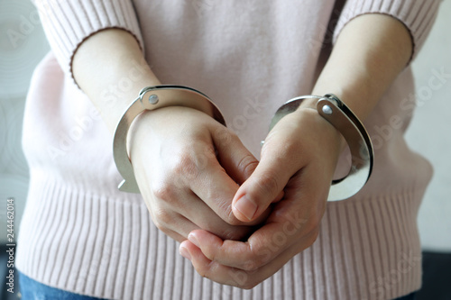Stampa su Tela The both hands of a woman in handcuffs.