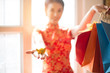 Leinwanddruck Bild - Chinese new year concept , Asian woman in chinese dress traditional cheongsam with gesture of congratulation
