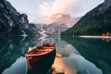 Autumn Time. Wooden Boat On The Crystal Lake With Majestic Mountain Behind. Reflection In The Water
