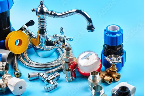 Fototapeta plumbing tools and equipment on blue background. obraz na płótnie