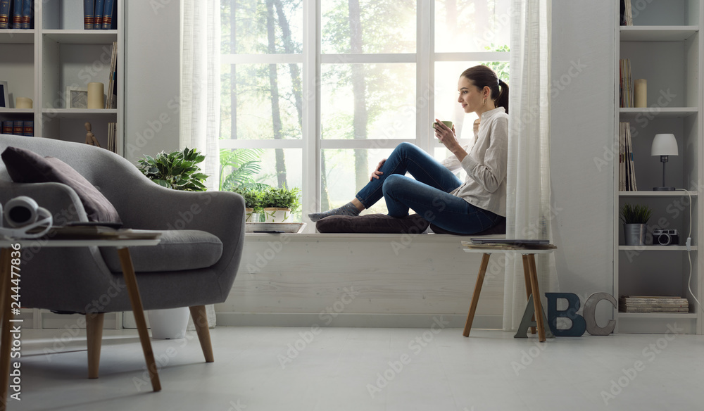Fototapety, obrazy: Woman relaxing at home and having coffee