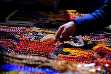 Colored Rosaries, Strings Of Colored Prayer Beads, Multicolored Beads From Seeds On The Market, Colorful Background