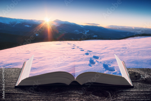 Fotobehang Lichtroze Mountain valley covered with snow on the book