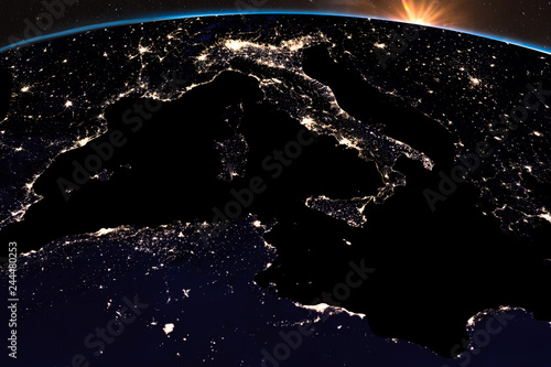Earth night light at central Europe. Italy close up view. Sunshine from space. Elements of this image furnished by NASA.