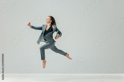 Happy business woman dancing and smiling in motion isolated over white studio background. Human emotions concept. The businesswoman, office, success, professional, , happiness, expression concepts