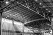 Interior of warehouse. large metal structures, ceiling. roof. concept production and installation of equipment for rooms, lighting, ventilation and windows for hangars, black and white