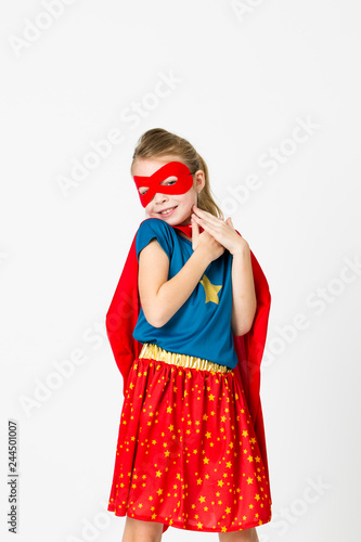 Photo  pretty blonde supergirl with red mask and red cape