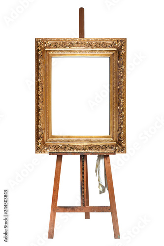 Photo Painter's easel and empty antique golden frame