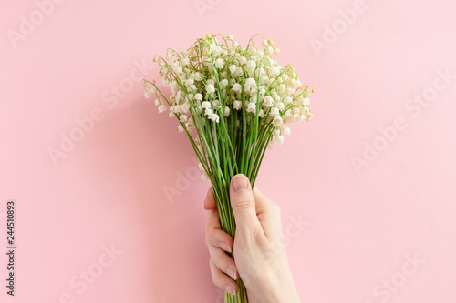 Photo Stands Lily of the valley Woman hold in hand bouquet of lilies of the valley