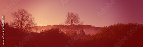 Spoed Foto op Canvas Bordeaux Dawn in the hilly terrain, meadow landscape countryside. Autumn season. Web banner for design. Color coral tonality.