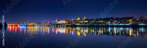 Fototapeta Warsaw, Poland - March 21, 2017: Great panoramic night view of the center and the Old City of Warsaw from the right bank of the Vistula River obraz