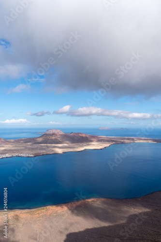 Photo Stands Spring Canary Islands, Graciosa island view from observation point Mirador del Rio