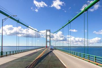 Driving Across Mackinaw Bridge. Four lane highway with traffic on interstate 75 crossing the Mackinac Bridge in Michigan.