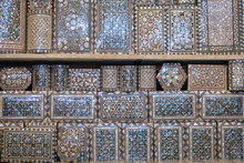 Selection Of Luxury Ornate Pearl Inlaid Boxes For Sale In The Market Square Souk Of Marrakesh