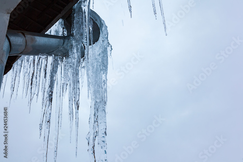 Fotografia, Obraz  Ice on the roof and downpipe on a winter day.