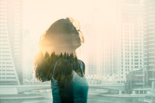 Double Exposure With Young Woman In The Modern Cityscape And Forest.