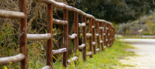 Chestnut Wood Railing On A Country Road