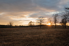 Beautiful Golden  Sunset On A Ranch In Oklahoma Sky Filled With Clouds
