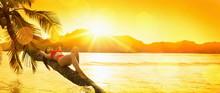 Free Woman Enjoys Ocean Breeze At Sunset. Summer Vacation