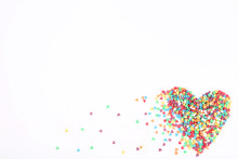 Colorful Heart Shaped Sprinkles On White Background